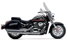The Suzuki Boulevard C90T is a tour-ready cruiser powered by a fuel-injected 90-cubic-inch V-twin engine that delivers exceptional torque for outstanding acceleration in every gear. A strong five-speed transmission and shaft-drive cleanly puts all that power to the ground. This bike also features fully integrated leather-look, rigid side cases and a comfortable passenger seat, all behind a large windscreen for remarkably comfortable cruising on the open road. With bold, classic styling, the C90T is also designed to capture attention whether you're cruising down the boulevard or kicking back at a rest stop.
